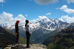 Two climbers looking at the mountains Royalty Free Stock Photography