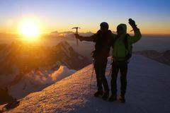 Two climbers on the summit of Mont Blanc at sunrise Royalty Free Stock Images