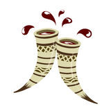 Two clinking horns with red wine Royalty Free Stock Images