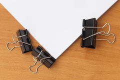 Two clips stapling papers Stock Image