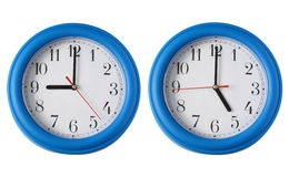 Two clocks, one on 9am and one on 5pm. Working 9 to 5.  Two clocks, one on 9am and one on 5pm Stock Photos