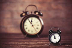 Two clocks. On wooden table royalty free stock photo