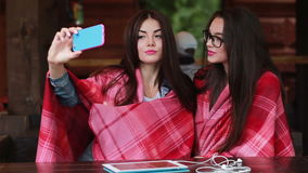 Two close friends do selfie in the cafe. Two close girlfriends want to make a selfie in the cafe on memory stock video