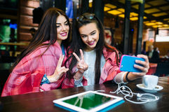 Two close friends make selfie in the cafe Royalty Free Stock Photography