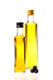 Two closed bottles of olive oil Stock Photo