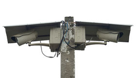 Two Closed Circuit Televisions (CCTV). / Cameras mounted on a concrete pole with covered shields (isolated Royalty Free Stock Images