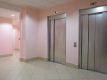 Two closed elevators in a business lobby Stock Images