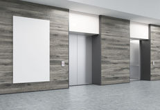Two closed elevators in corridor with wooden walls and poster. Two closed elevators with buttons in corridor with wooden walls. Vertical poster of elevator size Royalty Free Stock Photos