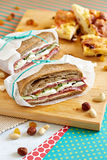 Two closed sandwiches with brown bread and salami Royalty Free Stock Image