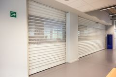 Two closed shutter. These roller shutters are closed on a high day stock images