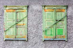 Two closed window of an old house Stock Photography