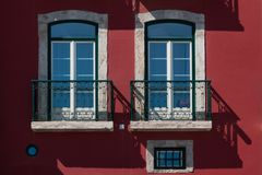 Two windows and a dark red facade Royalty Free Stock Image