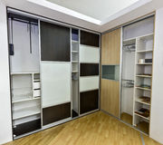 Two closets with sliding doors