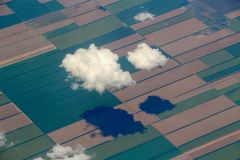 Two clouds and agriculture fields. Two clouds under the agriculture fields royalty free stock photo