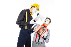 Two clown, MIME, flashy Megaphone. The expression of emotions. O royalty free stock images