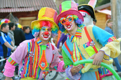 Two clowns. Image with two clowns posing a public place Royalty Free Stock Image