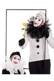 Two clowns in a frame with a yellow flower Royalty Free Stock Photos