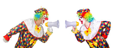 The two clowns with loudspeakers isolated on white Royalty Free Stock Photo