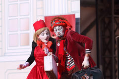 Two clowns perform on open air stage Stock Photo