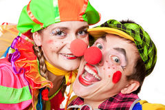 Two clowns smiling. Portreit two clowns smiling isolated over a white background Royalty Free Stock Photo