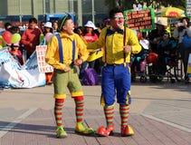 Two clowns telling jokes and joking. Royalty Free Stock Photos