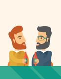 Two co- workers having fun drinking beer in a pub. A two hipster co-workers from office to pub having fun drinking beer just to relax and stress free. A Royalty Free Stock Images