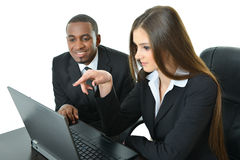 Two Co-Workers Looking at Laptop. And working as a team Stock Photos