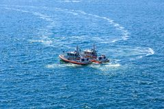 Two Coast Guard Boats. In Blue Water Royalty Free Stock Image