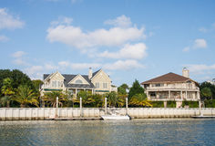 Two Coastal Homes with Small Boat Stock Photos