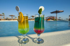 Two cocktail drinks by a tropical pool Stock Photo