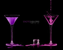 Two Cocktail Glasses with Colorful Spirit Drink Splashing. Templ Stock Photography