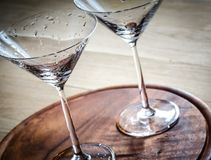 Two cocktail glasses. Two empty cocktail glasses on the wooden board Royalty Free Stock Photos