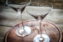 Two cocktail glasses. Two empty cocktail glasses on the wooden board Royalty Free Stock Photo