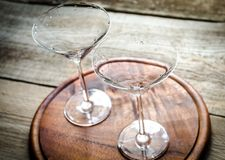 Two cocktail glasses. Two empty cocktail glasses on the wooden board Stock Photos