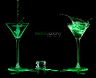Two Cocktail Glasses with Green Liquor. Style and Celebration Co Royalty Free Stock Photos