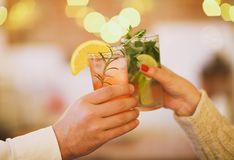 Two cocktail glasses in man and woman hand. Close up Stock Photo
