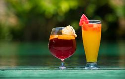 Two cocktail glasses by the pool. Two cocktail for couple Stock Photography