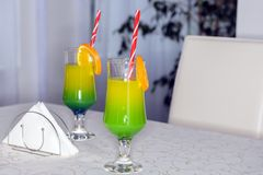 Two cocktail glasses on a table. In two colors Stock Images