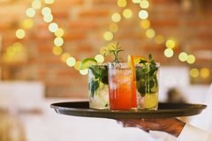 Two cocktail glasses on tray in the bar Stock Image