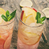 Two cocktail with ice, mint, lemon and apple Royalty Free Stock Photos