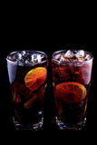 Two cocktail Long Island Iced Tea on a black background. Stock Photography