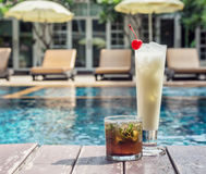 Two cocktail mojitos and pina colada in the misted glasses on th Royalty Free Stock Photos