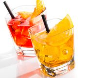 Two cocktail with orange slice and straw on top isolated on white background Stock Photography