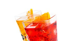 Two cocktail with orange slice on top isolated on white background Royalty Free Stock Photos
