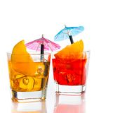 Two cocktail with orange slice and umbrella on top isolated on white background Royalty Free Stock Photography