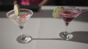 Two cocktails on the beach bar stock footage
