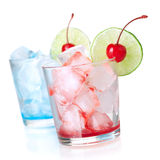 Two cocktails with lime slice and maraschino Royalty Free Stock Photo