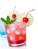 Two cocktails with lime slice and maraschino stock photography