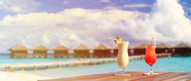 Two cocktails on luxury beach resort, panorama Royalty Free Stock Image