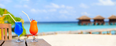 Two cocktails on luxury beach resort, wide panorama Royalty Free Stock Photo
